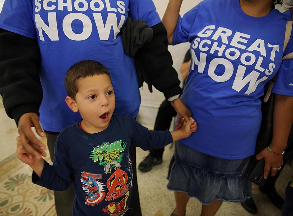 Ignacio Macias, 3, of Lynn attended a charter school campaign rally with his mother, Alicia Javier (left), and Paula Reyes.